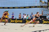 HERMOSA BEACH, CA - JULY 21: Kaitlin Sather and Michelle Moriarty compete in the Jose Cuervo Pro Bea