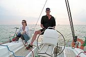 Sailing on the IJsselmeer at Pampus in the Netherlands with sunset