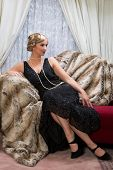 Color photo with reenactment of a vintage scene with a lady in the roaring twenties style