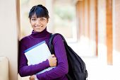 cute female teen indian high school student portrait in school