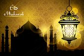 illustration of Eid Mubarak greeting with illuminated lamp