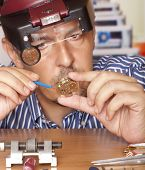 image of watch  - Watch repair craftsman repairing watch - JPG