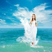 image of white gown  - Aphrodite Styled Woman in Splashing Dress Walking on Water - JPG