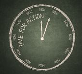 picture of clocks  - Time for Action written on the blackboard with clock - JPG