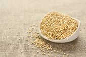 picture of sackcloth  - Quinoa grain in white ceramic bowl on sackcloth background - JPG