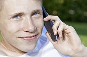 Teenager talking in smartphone