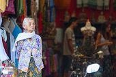Old Balinese Woman Near Souvenir Shop In Ubud
