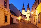 image of saint-nicolas  - Historical street in Trnava with Saint Nicolas church Slovakia  - JPG