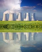 Nuclear Power Plant With Reflection In Water At Spring