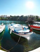 Boats At Voulismeni Lake In Agios Nikolaos. Crete