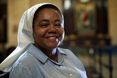 picture of nun  - Woman and religion portrait of catholic nun praying in church and looking at camera - JPG
