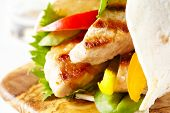 picture of fresh slice bread  - Fresh tortilla wrap with grilled pork and vegetables - JPG