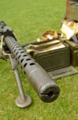stock photo of sub-machine-gun  - looking down the barrel of a machine gun - JPG