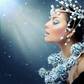 Winter Beauty Woman. Christmas Model Girl Makeup. Holiday Make-up. Snow Queen High Fashion Portrait