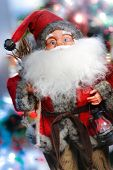 stock photo of merry chrismas  - mini santa claus on the chrismas tree - JPG