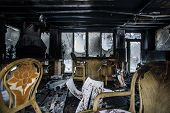 stock photo of fire insurance  - Fire damaged interior details in summer house after blaze - JPG