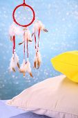 pic of dream-catcher  - Beautiful dream catcher and pillows on blue background - JPG