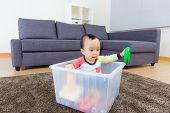 image of baby doll  - Asian baby boy playing at living room - JPG
