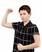 Portrait Of A Young Boy With Hand Raised Up And Showing Muscles