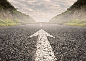 picture of horizon  - arrow on asphalt road to the horizon - JPG