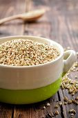 pic of buckwheat  - Raw green buckwheat in a bowl on a wooden table - JPG