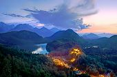 stock photo of bavaria  - Panoramic view at twilight of the illuminated Castle Hohenschwangau Bavaria Germany - JPG