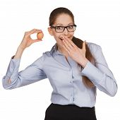Surprised Woman In Glasses Holding An Egg