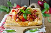 stock photo of tarts  - Apple tart with cinnamon on an old wooden table - JPG