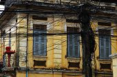 Electric Wires In Front Of A Colonial Old House