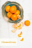 Clementines on rustic white board