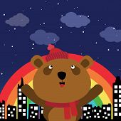 Brown bear in the city at night