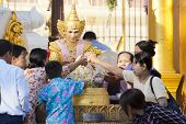 Offering At The Schwedagon Pagoda