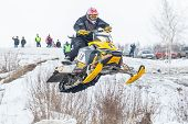 Flying of sportsman on snowmobile