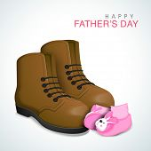 Baby booties with father leather shoe on grey background, concept for Happy Father's Day celebrations.