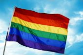 image of gay pride  - a rainbow flag on a sky blue - JPG