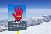 Avalanches warning sign in ski resort