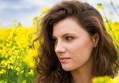 beautiful girl portrait in yellow flower field