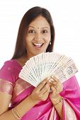 Excited Traditional Woman With Indian Currency