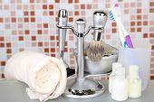 Male luxury shaving kit on shelf in bathroom