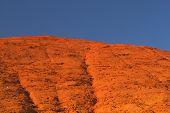 Ocher Hill And Blue Sky.