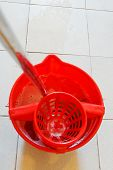 Mop In Red Bucket With Foamy Water