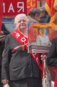Old woman with Stalin's portrait on parade