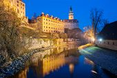 Castle with the famous round tower in Cesky Krumlov, Czech Republic is reflecting in the river Vltav