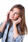 Teenage Girl In Denim Jacket Listening To Music