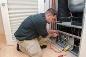 stock photo of voltage  - HVAC technician working on a residential heat pump - JPG