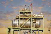 pic of boiler  - Boiler or Deaerator machine in power plant with blue sky background - JPG