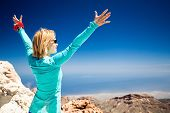 stock photo of canary-islands  - Hiking woman and success in mountains - JPG