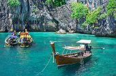 Thailand ocean landscape with traditional long tail boat