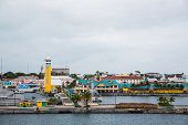 Tower And Harbor At Port In Nassau.