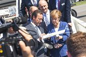 BERLIN, GERMANY - MAY 20, 2014: German Chancellor Angela Merkel look model airplane Airbus A350 XWB